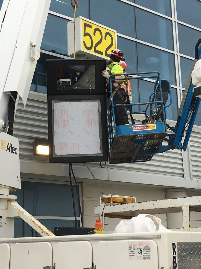 An A-VDGS display cabinet is installed at a Pearson airport gate.